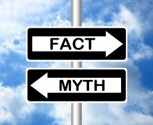 One way street signs that say fact and myth
